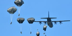 Paratroopers depart from Hercules during military exercises in Italy