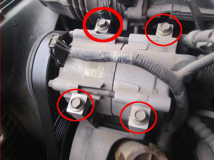 Check that the AC compressor mounting bolts are tight.