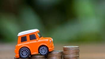 1635327081 miniature car model and financial statement with royalty free image 1583760626