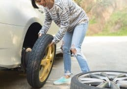 young women changing a flat tire picture id667607310